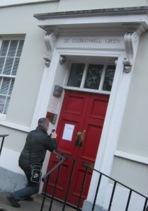 Photographing the 'We are definitely closed' sign at the Marx Memorial Library, 37a Clerkenwell Green